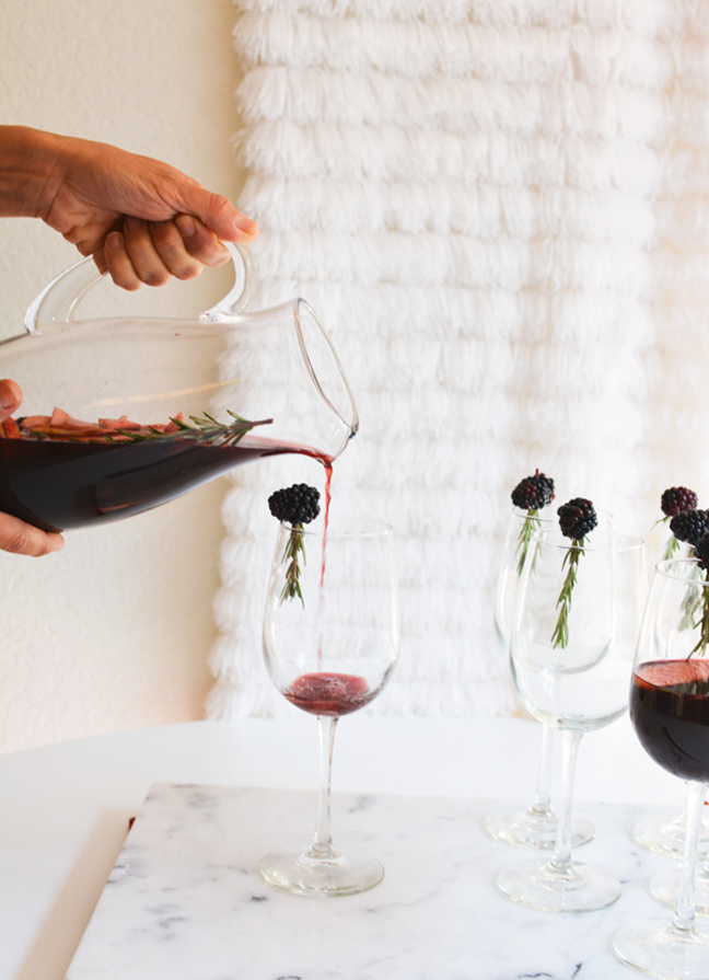 pouring wine wine sangria into wine glasses
