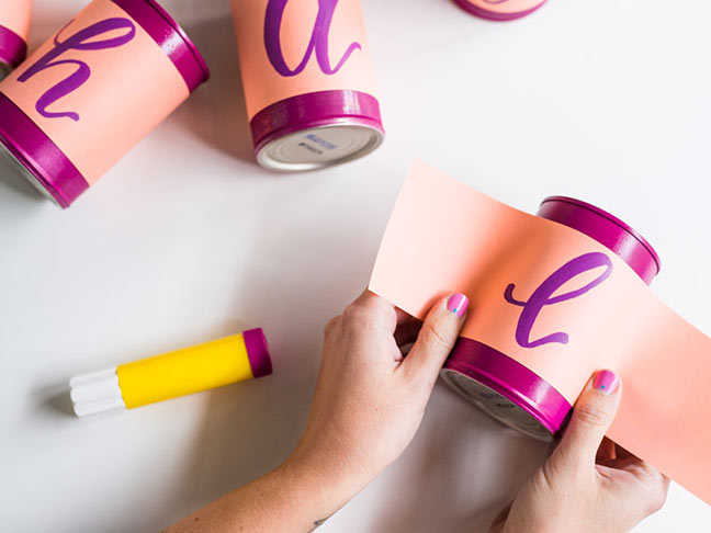 Attach paper to cans for centerpiece
