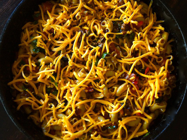 macaroni-meat-green herbs-grated orange cheese