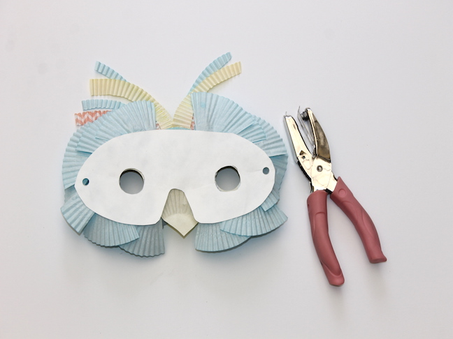 back of owl shaped mask hole punch