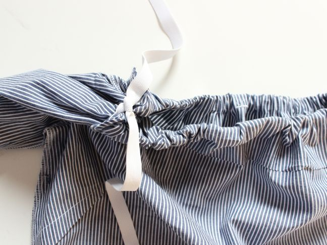 white-elastic-double-knotted-inside-a-top