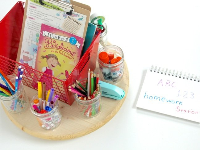 DIY-turntable-homework-station-with-school-supplies-markers-stapler-red-metal-basket-on-a-round-wooden-table
