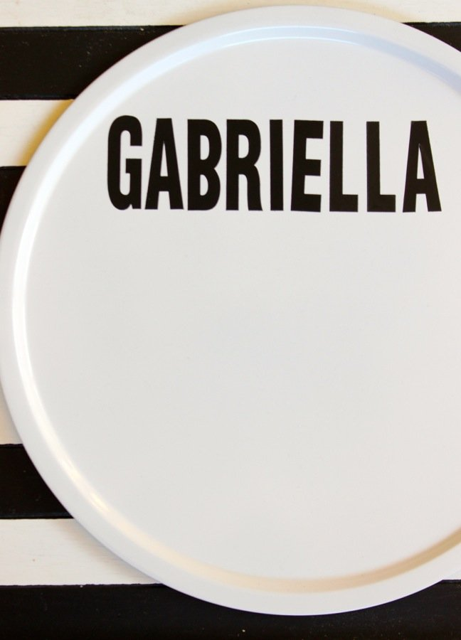 white-round-pizza-pan-with-black-letters-gabriella