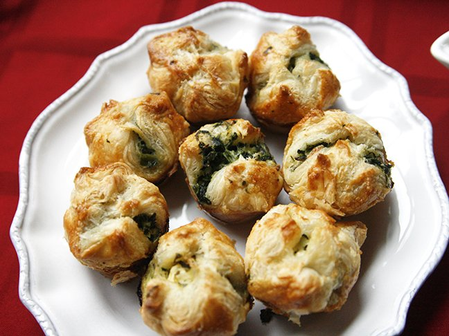 my spinach and cheese puffs are the perfect holiday appetizer flaky crunchy pastry surrounds a mouthwatering cheese and spinach filling