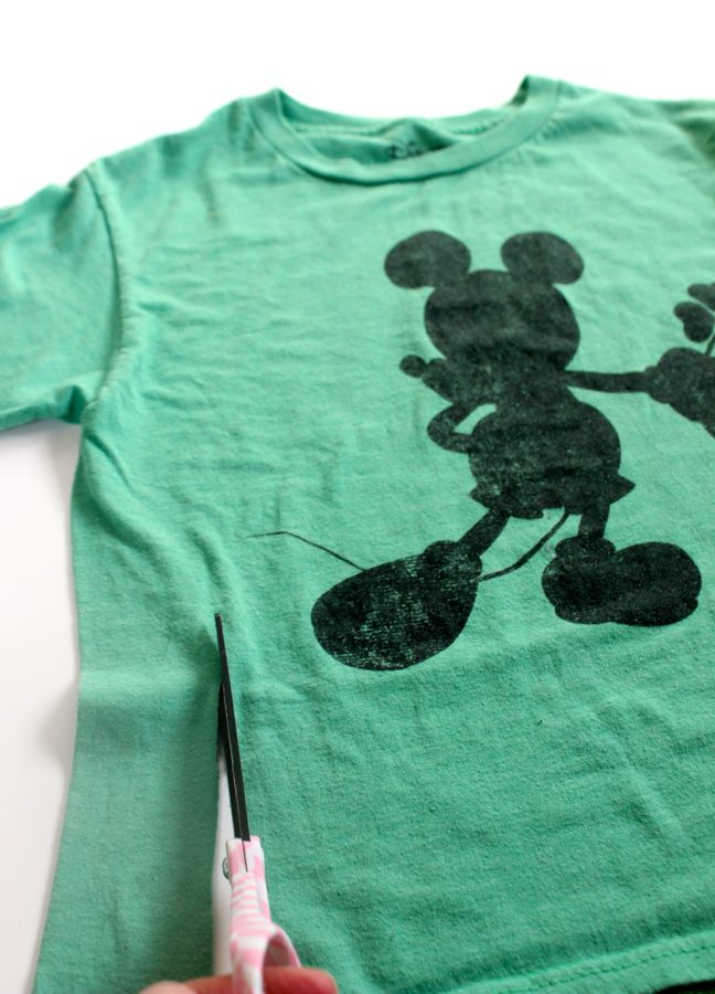 cutting-a-green-mickey-shirt-with-scissors