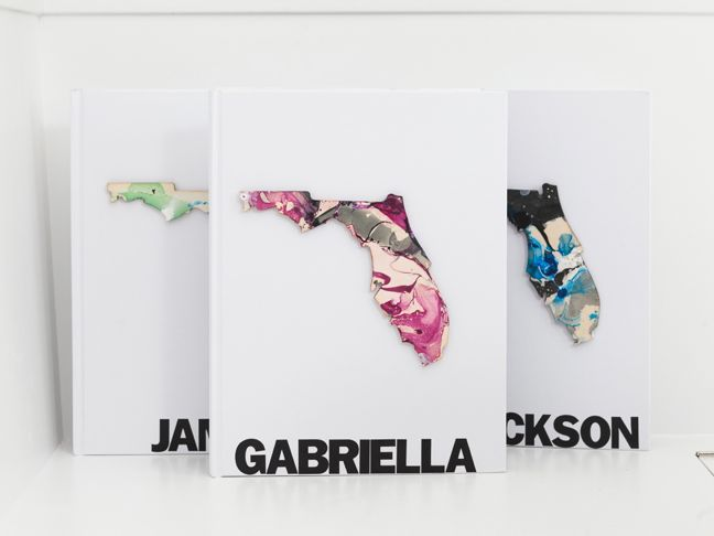 white-scrapbooks-with-marbled-florida-cut-outs