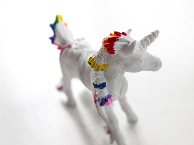 white-toy-unicorn-with-rainbow-hair