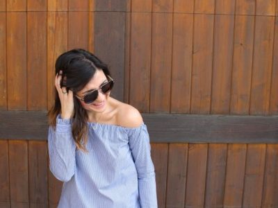 woman-wearing-a-blue-and-white-striped-off-the-shoulder-shirt