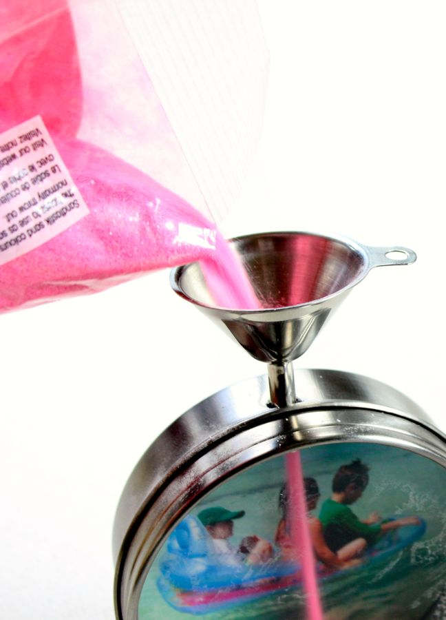 pouring-pink-sand-into-a-metal-funnel-for-a-diy-sand-art-frame