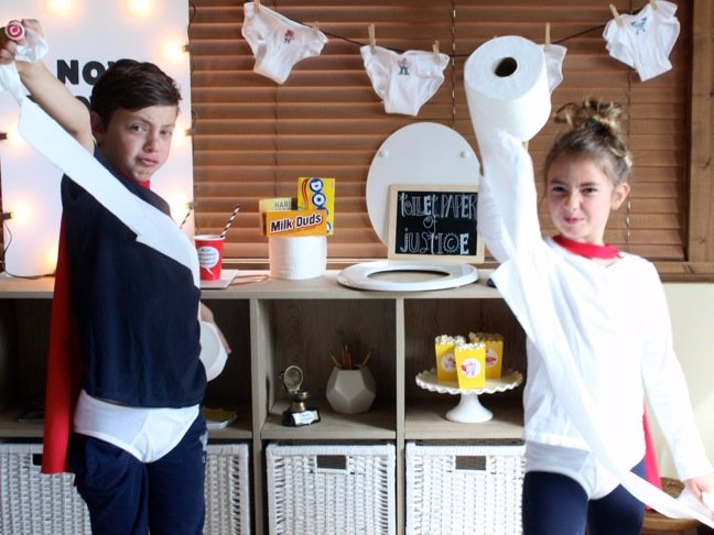 boy-and-girl-plating-with-toilet-paper-at-a-captain-underpants-party