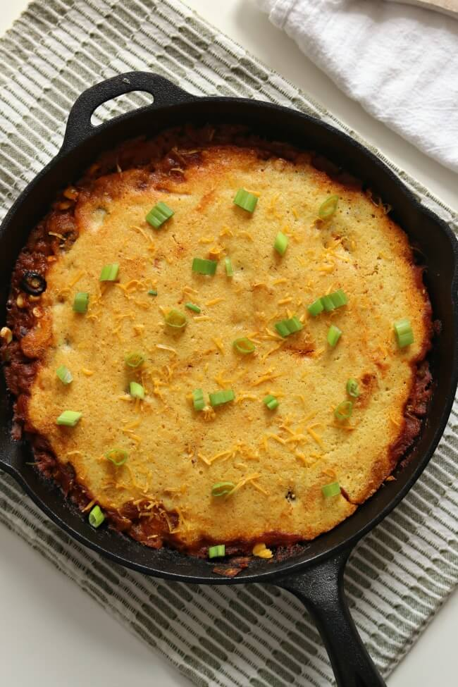 Tamale pie is classic American comfort food. It has a chili-like filling with cornbread baked right over the top. The bonus is that it's all made in one skillet making clean-up super easy!