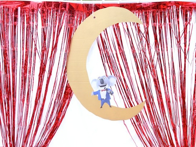 diy-kids-stage-with-red-fringe-metallic-curtain-and-buster-moon-koala-character-from-sing
