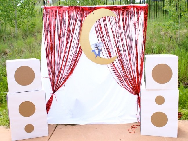 sing-stage-for-kids-with-cardboard-speakers-and-a-red-metallic-curtain-outdoor-mini-diy-stage
