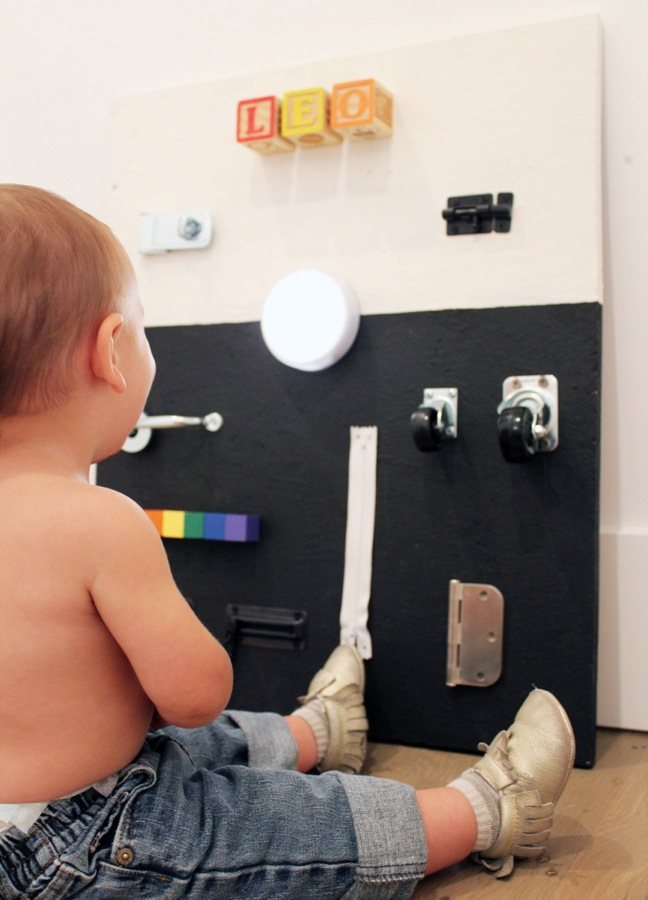 diy-black-and-white-busy-board-for-toddlers-with-hardware-and-rainbow-blocks