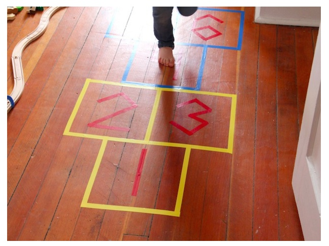 Recreate the feeling of a park day with indoor hopscotch.
